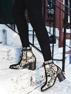 Verrico Lace Up Boot   Made a statement in these super luxe lace-up ankle boots featured in an animal print.  Inside zip closure for an easy on/off.  Stacked block heel.