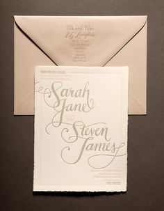 Guernsey Island Wedding invitations. Two color letterpress printed on Arturo paper with handmade edges. Wrapped with gold thread and abalone shell native to the island. Designed and printed by Ladyfingers Letterpress.