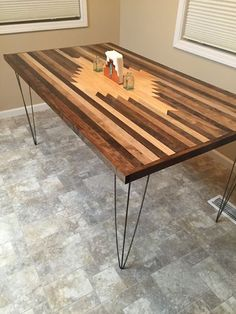 Don't want to spend $1,000 on a beautiful wood table? Make your own, and customize it to your tastes. This one has a gorgeous Southwestern motif.