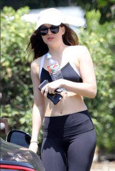 Johnson flashes her fit abs in tight athleisure outfit Sporty spice! Dakota Johnson flaunted her flat abs in tight workout gear while fetching coffee with a friend in LA FridaySporty Sporty may refer to: Dakota Johnson Body, Dakota Johnson Stil, Dakota Johnson Street Style, Dakota Mayi Johnson, Athleisure Outfits, Sporty Outfits, Dakota Jhonson, Tights, Celebs