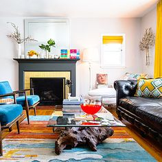 Sunset Magazine: recovered chairs in Ikea curtains, and used gold leaf on bricks around fireplace. Cool.
