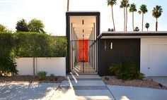 Exterior Ideas: 12 Brightly Colored Front Doors -- Photo by Chimay Bleue The red color helps visitors spot the entry at the end of a long pathway to this mid-century Palm Springs home sited on the Canyon Country Club Golf Course. Front Door Design, Front Door Colors, Front Doors, Modern Exterior, Interior And Exterior, Exterior Colors, Modern Architecture, Architecture Details, Palm Springs Mid Century Modern