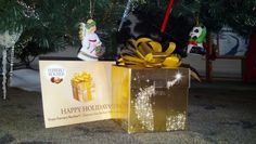 My Influenster Holiday Treat Box!  You can send a free golden greeting by following the link and win a box of Ferrero Rocher chocolate!