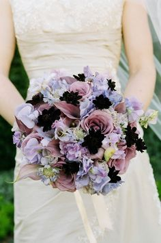 Bridal bouquet of lavender roses, sweet peas, calla lilies, scabiosa, and chocolate cosmos.