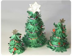cute christmas table centerpieces | Make these cute minature christmas trees made from paper.
