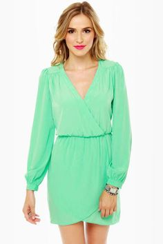 Check it out from Lulus.com! Put an end to wardrobe indecision with the That's a Wrap Long Sleeve Mint Green Dress! Woven mint fabric parades down a surplice bodice with flattering gathered waist plus full skirt to ensure you'll never be stuck wondering what to wear again! Long sleeves have button cuffs. Model is wearing a size small. Small measures 31