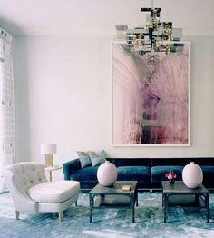 Modern interior design with a navy sofa, via @sarahsarna