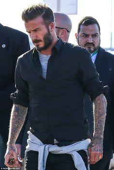 David Beckham shows off tattoos as he attends Super Bowl football game #dailymail