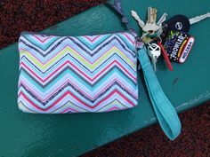 Wristlet key fob attached to mini zipper pouch. Great to carry if you don't want to bring your purse! #Thirty-One #31