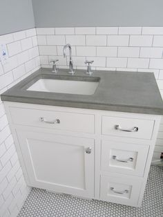 concrete counter, love the faucet, subway tile....like the vanity...