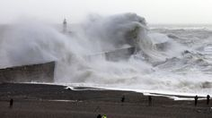 About 13,000 homes are without power and travel is disrupted as Storm Imogen brings heavy rain and winds of up to 96mph to parts of Britain.