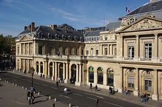 The Palais-Royal in Paris is a palace and an associated garden located in the 1st arrondissement of Paris. Facing the Place du Palais-Royal, it stands opposite the north wing of the Louvre.