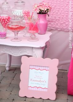 old night stand painted pink and re-purposed to a candy table.