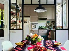eclectic vintage bohemian industrial modern kitchen / dining room with ikat textiles