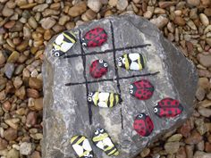 Bug and Bee tic tac toe game for the garden with rocks