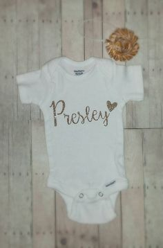 Personalized custom name baby girl onesie bodysuit with heart in white and gold glitter hospital outfit cute adorable Hey, I found this really awesome Etsy listing at https://www.etsy.com/listing/242681644/personalized-custom-name-baby-girl