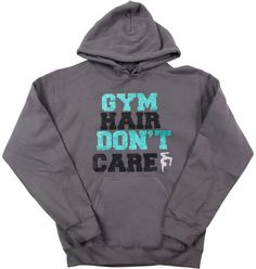 """Gym Hair Don't Care Gymnastics Sweatshirt~ We all have those gym hair days! This sweatshirt is for us/you. Made from a nice grey sweatshirt it is then accented with mint and black glitter vinyl that states """"Gym Hair Don't Care"""". On the side is a gymnast in silver glitter vinyl. Purchase yours today."""