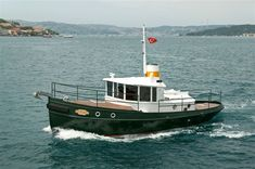 Terrier is one of the finest examples of a small motor yacht in a classic Tug Boat style. Tug Jobs, Deck Boat, Boat Fashion, Yacht Boat, Motor Yacht, Power Boats, Trump, Boat Plans, Wooden Boats