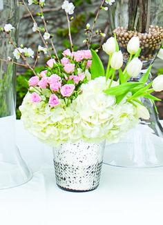 Winter centerpiece idea in an icy mercury glass vase.