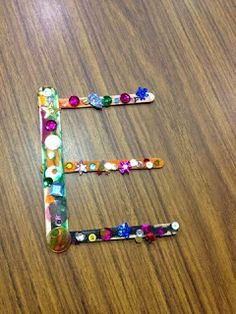 Popsicle sticks are great for forming letters with straight lines (A, E, F, M, N, etc.)!