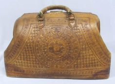 The Mexican Leather Work is Hand Made.  This is an Antique Satchel Bag.  Just Beautiful!