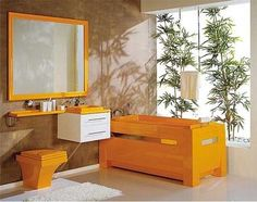 Adding colors that mimic wood and some Japanese greenery makes any bathroom feel like a zen Japenese garden oasis.