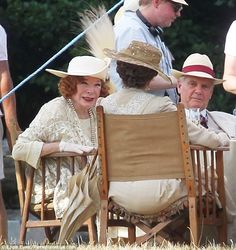 High society: Shirley pops on a feathered cap as her character hosts a society picnic