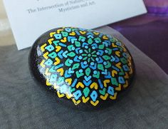 Hand-Painted-Alchemy-Stone-with-Green-Blue-Yellow-Geometric-Mandala-Design