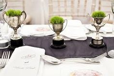 grass planted in silver trophies