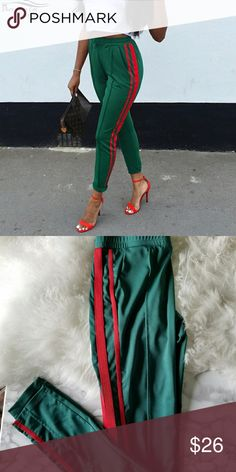 Sweatpants Green sweatpants with 2 red stripes on the side  Bought it online it has no brand Pants