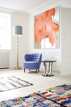 I can't say I would choose the rug in the foreground, but I like the idea of modern art on a mirror in a monochromatic room (though I would keep the paint on the mirror in the same color as the room).