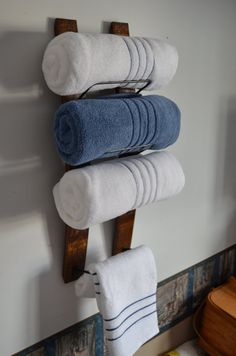 Updated towel rack design!  Similar to a wine stave wine rack, Ive made this a bit shorter, approximately 29 long and Ive expanded the cradle