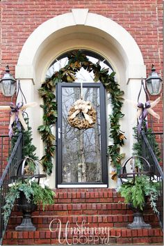 Gorgeous Christmas decorations on a front porch. Magnolias and urns filled with greenery