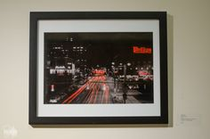 """""""Red Harbor""""  View down Pratt St. in Baltimore, MD.  16x20 Framed/matted photo printed on metallic paper.  White mat/ Black frame    This photo was originally on display in in my 1st solow show """"SidJacks: A Closer Look"""" in 2014 and Baltimore City Hall and BWI Airport in 2015.     Price does not include shipping 
