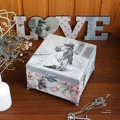 This is a Marilyn Monroe wooden Trinket Box. It is garnished with a decoupage technique and hand painted. The surface is protected with transparent lacquering. The black and white design of the casket is supplemented with metallic accessories of a bronze-antique shade. There is lovely