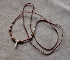 Kit fox tooth necklace by Lupa. At http://thegreenwolf.etsy.com