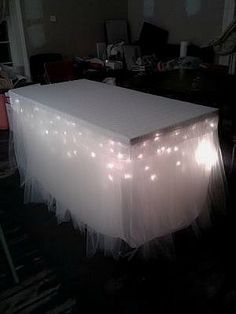 string icicle lights under table, tulle