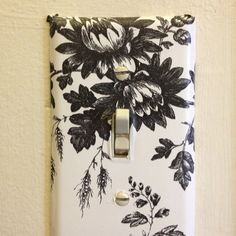 Home made lightswitch covers! I found this fabulous French country contact paper @ the dollar store for $2. It matched my new laundry room theme, so all my switch plates got makeovers for 50 cents each! Took me 5 minutes :)