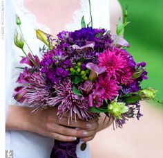 NEW: Heather's mainly purple bouquet was comprised of chrysanthemums (the primary flower for the wedding because they're the perfect bloom for fall), spider mums, and lisianthuses.  From the album: Heather & Jason: An Eco-friendly Wedding in Manitou Springs, CO