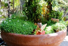 I'm am so making a fairy garden instead of a water feature garden. This would be so darling!