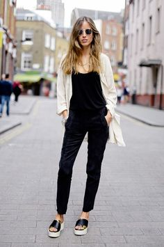 Pair black overalls with a draped cardigan and flatforms for a fashion-forward look