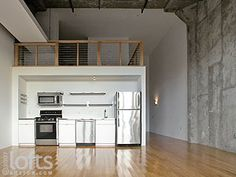 Another great idea for my mezzanine -open up the space, and put the Kitchen underneath!