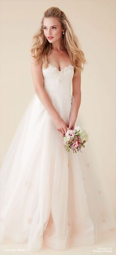 A whimsical beauty, Provence's innate charm is due to a penchant for all things airy and abloom. Scattered with gossamer flowers from the softly ruched sweetheart neckline to the hem, this tulle wedding dress is a natural for a day dedicated to true love.
