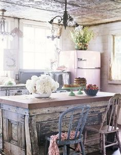 Love the vintage fridge, tin ceiling, distressed wood. I would overhang the top on the island so the chairs tuck under. Have to have room for your knees to be comfortable.
