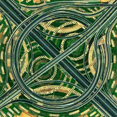 A whirlpool interchange connects three major roads by the Miracle Garden in Dubai, UAE. When construction of this junction began in 2006, Dubai contained 30,000 industrial cranes - 25% of all cranes on the planet.