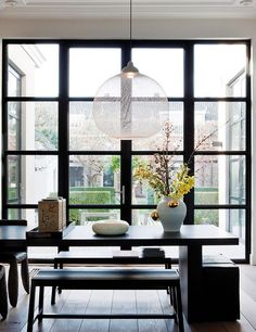 contemporary dining space (those windows and that pendant...)