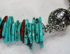 Gorgeous cowgirl western / southwest style necklace is hand created using graduated howlite turquoise heishi beads in colors of turquoise and brown, two large pewter silver fancy ball beads, tiny howlite turquoise round beads, Tibetan silver bead caps and spacers complete this fabulous cowgirl western look !  Approx. Necklace Measurement: 20 3/4 inches.  Matching Earrings Length: 1 /34/ inches hung from STERLING SILVER ear wires.  Large silver metal heart lobster claw clas...