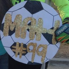 Boys high school soccer game sign #99 goal keeper