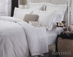 Davinci Chiara 3 Pc Quilt Cover Set Embellish luxurious 100% cotton sateen, 400 thread count bed linen with an elegant guipure lace insert.  Chiara quilt cover sets are available with either a defining black lace insert or for the purists, a snow lace insert.