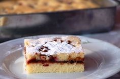 Ingredients: For the batter 2 large eggs ¾ cup sugar ½ cup milk ½ cup melted butter (or oil) 2 cups flour 1 pouch baking powder 1 tbsp vanilla (or 1 pouch vanilla sugar) a pinch of salt  For the filling 10-15 plums (pitted and diced) ½ tbsp cinnamon 3 tbsp plum jam (or marmalade) 1-2 teaspoons rum  Method: Preheat the oven to 180 °C. Grease a 30x20